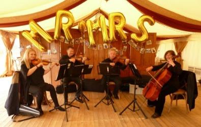 Cotswold Ensemble String Quartet: Jo, Stewart, Neil & Fiona:   Wedding reception at a farm nr. Moreton-in-Marsh, Glocs