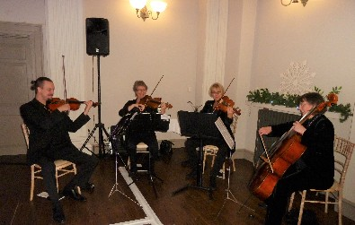 Cotswold Ensemble String Quartet Christmas party music at the Kings Head, Cirencester, Gloucestershire