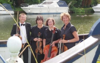 The Cotswold Ensemble String Quartet afloat on a wedding boat, Streatley on Thames, Oxfordshire